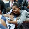 First Lady Michelle Obama Hugs Sweaty Team USA Players After Beating France