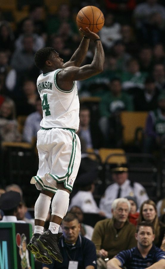 """2eb345749d5 2). Nate Robinson shows his outside range in the Air Jordan XIII """"3M  Altitude""""."""